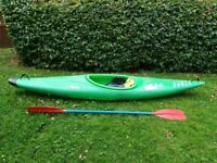 Euro Kayaks Conquest 10 foot kayak and paddle and new spray skirt.