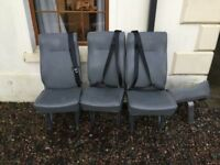 3seats with seat belts attached and 1 fold up seat good condition would suit back of land rover