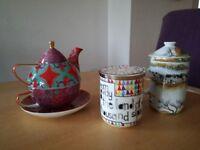 Three teapots/cups