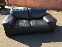 Black leather 2-seater sofa bed - good condition!
