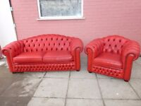 A Red Leather Chesterfield Two Piece Suite