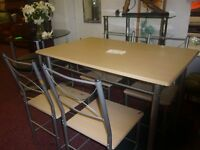 Pine table with metal(underneath) surround including 4 metal and pine chairs