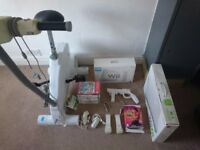 Ultimate Nintendo Wii Bundle - Wii Console + Wii fit board + Wii bicycle + 13 games + 2 controllers