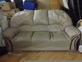 leather biege sofa in fair cond only £30