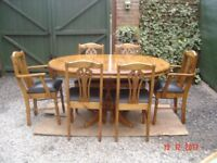 Pine Extending Oval / Circular Dining Table with Six Chairs ( Two Carvers). Can Deliver.