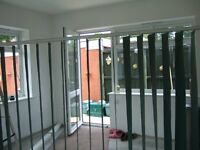 DARK GREEN VERTICAL WINDOW/CONSERVATORY BLINDS,WITH TRACKS,ONE SIDE IS BLACKOUT.GOOD USED CONDITION.