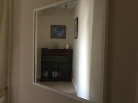 Mirror with white surround.