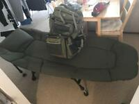 Fishing bed chair and big rucksack.