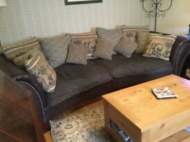 Leather and fabric sofa in used condition.