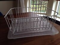 White dish rack and plastic clear mat