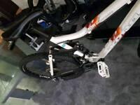 Kona and orange mountain bike