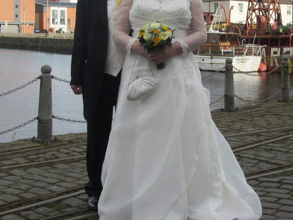 Wedding dress, as new and dry cleanedin DundeeGumtree - Wedding dress in ivory, size 22. Embroidery and beading on front and down one side. Sleeves with embrodery on shoulder and wrists. Zip back leading to row of buttons and dress floats outwards at back