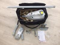 Polti steam cleaner with accessories and carry case