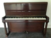 Upright piano by W H Barnes.