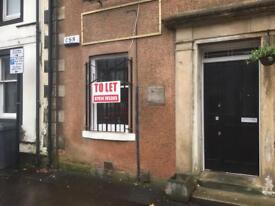 Shop unit for let on buzy main street cumbernauld village