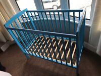 Blue cot and mattress