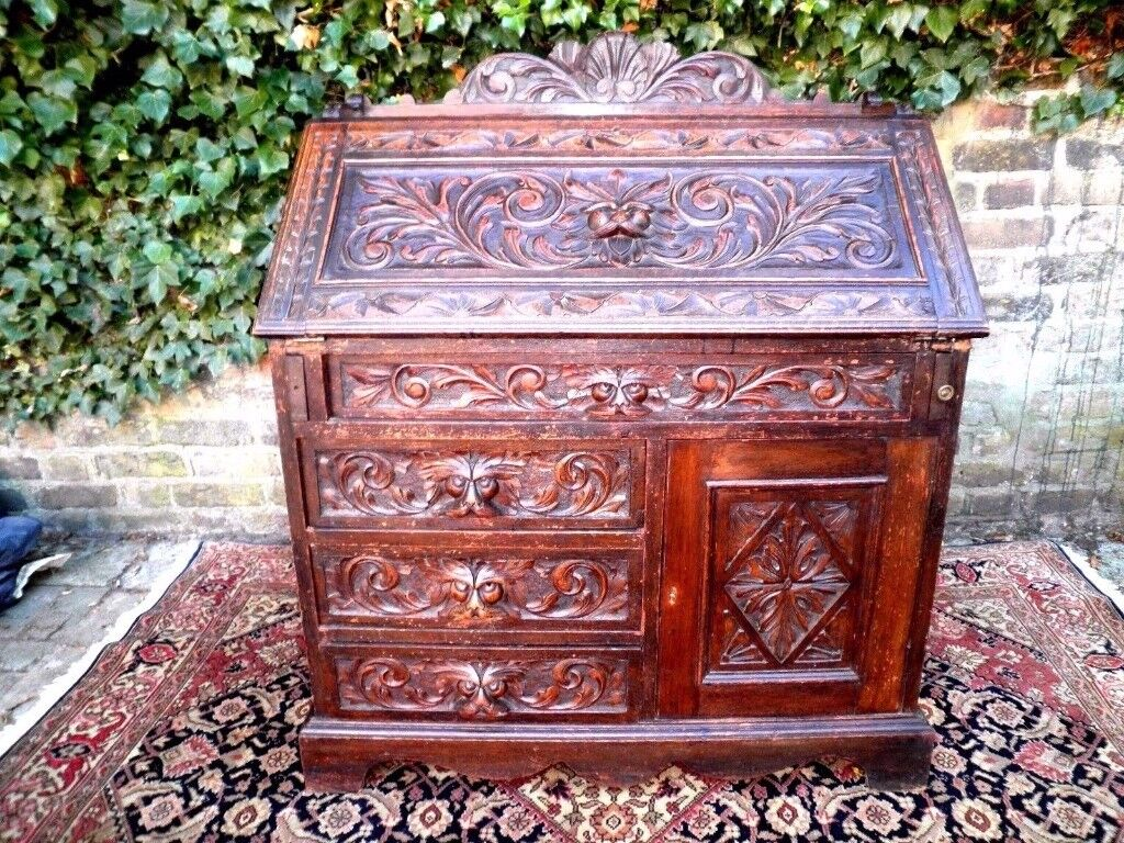 GENUINE ANTIQUE MID VICTORIAN HAND CARVED GOTHIC OAK GREEN MAN CARVINGS BUREAU VERY SOLID. V.G.C.