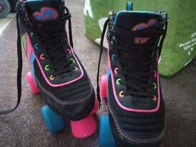 Children's roller skates. Excellent condition as they have been barely used . £20 per pair.