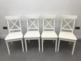 Four white dining chairs - IKEA INGOLF