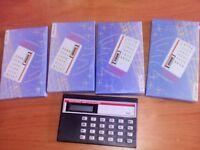 4 x mini calculators