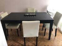 Wooden dinning table and 6 beige leather chairs