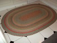 Oval Multi coloured rug, size 73 inches x 50 inches. Suitable for kitchen / conservatory.