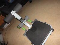 GREEN floor exercise equipment.