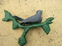 CAST IRON BIRD ON A BRANCH