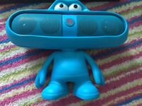 Two speakers, pink and blue Beats pill