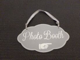 Sign and props for a photobooth
