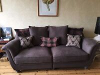 Grey three seater sofa with matching cushions, like new condition