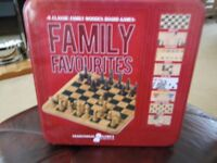 a large tin with 9 x family favourites board games brand new