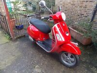 VESPA GTS125, 58 PLATE, RED, RACK,VGC,NEW MOT,11000MILES, 2 OWNERS, HPI CLEAR, ANY INSPECTION