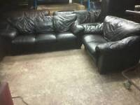 Black leather 2 and 3 seater sofa