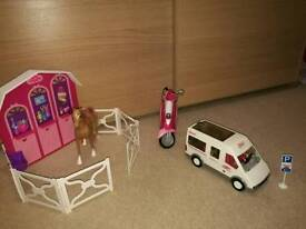 Horse stable (and horse) and motor bike (and barbie) and bus (with sign and mini people)
