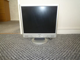 "17"" computer monitor with built in speakers."