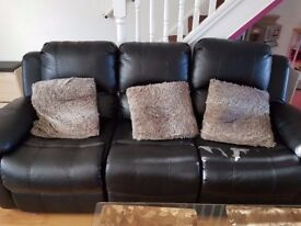 2 x 3 seater leather type black sofas with recliner