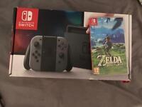 Nintendo Switch Grey 2 games and 1.5 year warranty
