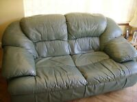 Large two seater sofa in green leather, good condition