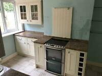 Used kitchen with granite worktops.