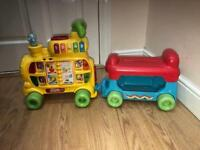 Child's rideable V-tech musical train and carriage