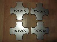 Toyota Corolla alloy wheels central caps, Excellent condition.£20.00