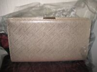 Ladies gold coloured clutch bag by Monsoon.