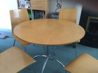 Round laminated pine effect table with metal frame legs and 4 matching chairs