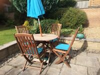 WOODEN TABLE AND 4 CHAIRS TOGETHER WITH UMBRELLA AND SEAT PADS