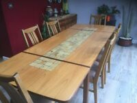 G PLAN TEAK DINING TABLE AND 6 CHAIRS
