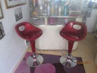 Two red crimson bar stools