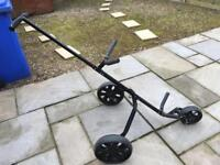 Golf trolley, three wheeled.
