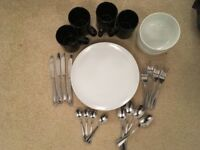2 big plates, 2 bowls, 4 mugs and cutlery (4 forks, 4 knives, 4 big and 4 small spoons)