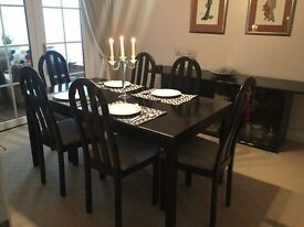 Dining table + 6 chairs, black ash, pretty perfect. Extends to seat 8. Matching unit available.